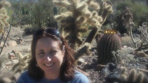 Ruth Ann Monti posing with cacti - another prickly situation