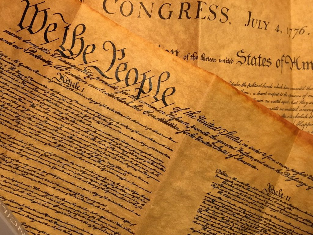 Images of the Declaration of Independence and the Preamble to the US Constition.