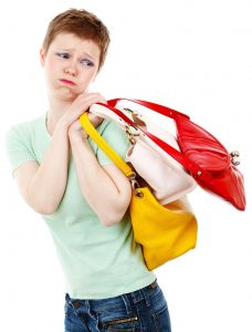 sad woman with several purses